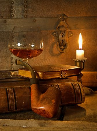 The good life, cognac, book and pipe