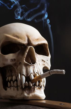 Skull with a cigarette, and blue smoke