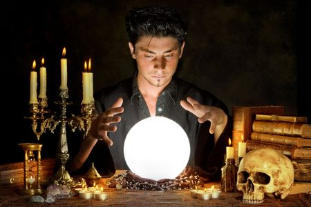 Halloween scene of a young sorcerer and his crystal ball