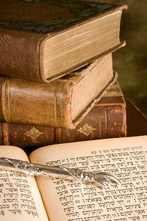 Silver Torah pointer lying on a jewish prayer book