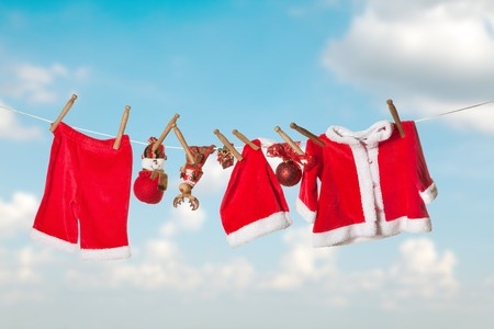Santa claus laundry hanging on a clothesline in the sky