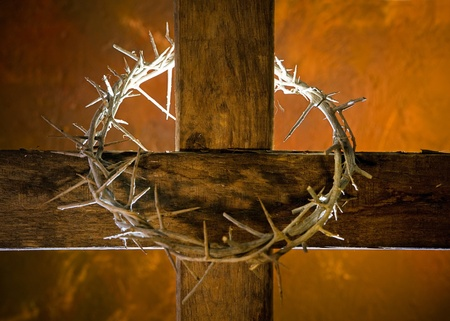 Crown of thorns hung around the Easter cross