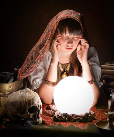 Diviner predicting the future with a crystal ball
