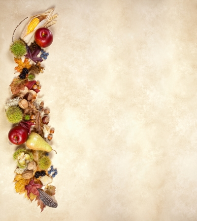 Vertical composite of autumn fruits leaves and nuts on jute