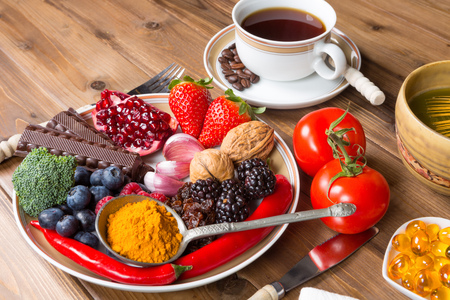 Wooden table filled with antioxidant drinks and food
