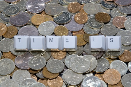 Business concept: time is sign on money background