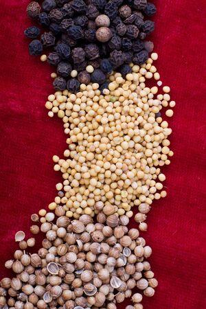 Spice set - coriander, white mustard grain; black pepper on red cloth