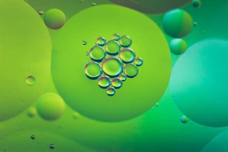 Photo for Oil drops in water. Abstract defocused psychedelic pattern image green colored. Abstract background with colorful gradient colors. - Royalty Free Image