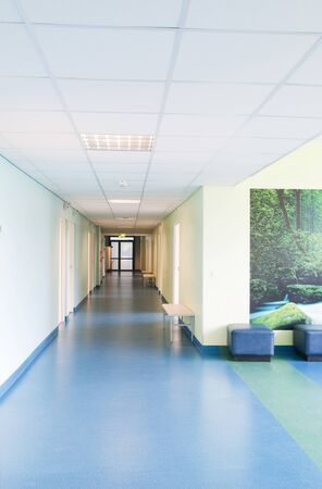 Photo pour Long corridor in hospital with doors and reflections - image libre de droit