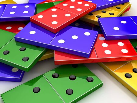 Scattered colored shiny bones dominoes on light background