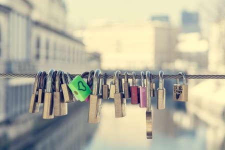 Photo pour Green love lock over the river - image libre de droit