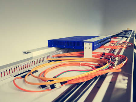 Fiber optic cables running from a switch.