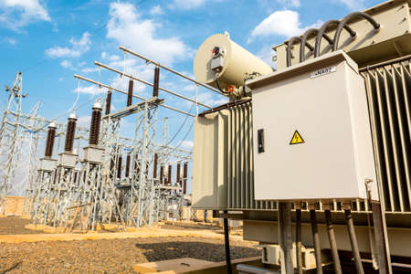 Photo pour Power utility box on a power transformer in substation switchyard. - image libre de droit
