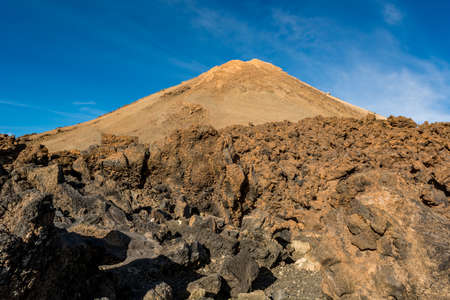 Majestic volcanic cone rising above spectacular lava shaped landscape.