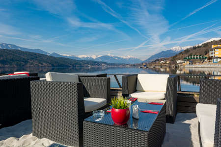 Luxury lake resort with spectacular mountain view. Lounge area above water.