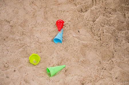 Foto de Drop down view of sand toys on beach. - Imagen libre de derechos