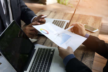 Photo pour banker businessman people group working with laptop and financial document chart on wood table together. - image libre de droit