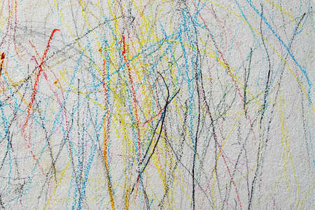 Drawing with colored pencil on the wall of a child.