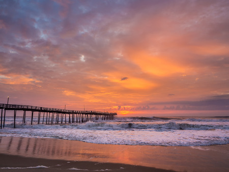 Serene sunrise over fishing pier at North Carolina Outer Banks