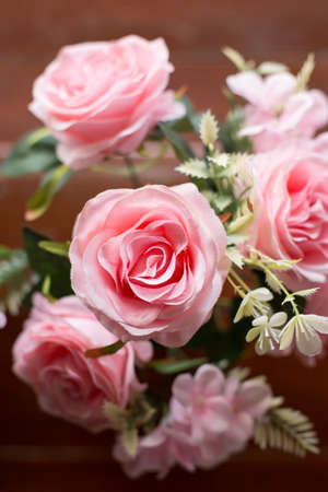 Photo for Beautiful pink roses on the old wooden table background - Royalty Free Image