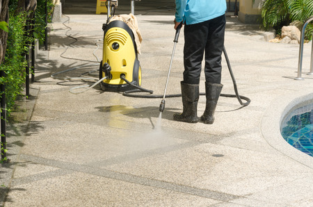 Foto de Outdoor floor cleaning with high pressure water jet - Imagen libre de derechos