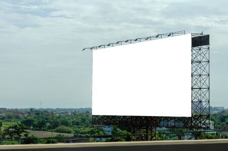 Photo pour Blank billboard for advertising text or pictures on the road. Clipping path - image libre de droit