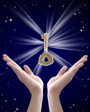 the key to success (hand holding key against night sky)
