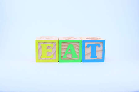 The word Eat spelled out with block letters on a white background