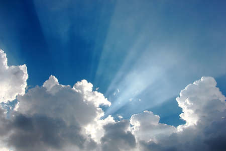 Foto de colorful blue sky with tiny clouds and sun rays - Imagen libre de derechos