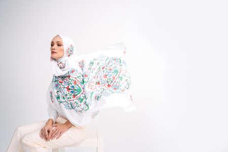 Photo pour Beautiful Arab Female model wearing hijab isolated over white background.Close up shot.Hijab Fashion. - image libre de droit