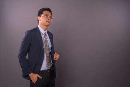 Photo pour Confidence young intrepreneur or business man with copy space.Studio shot. - image libre de droit