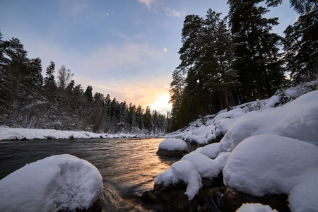 Photo for Winter mountain river with snow and green water on the sunset. Bolshoy Zelenchuk River. Russia. - Royalty Free Image