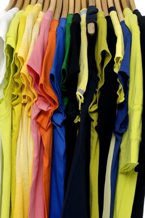 Photo pour t-shirt on hangers background - image libre de droit