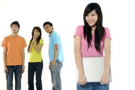 Asian group of happy friends –focus on girl holding a laptop computer