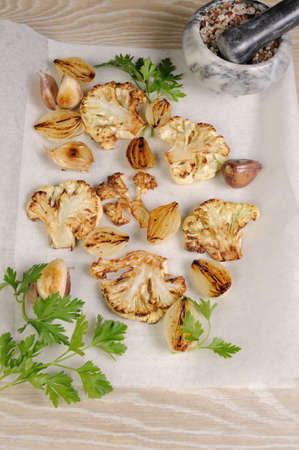 Warm appetizer of fried pieces of cauliflower with garlic and onion