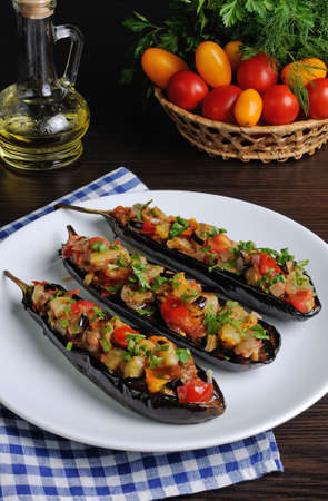 Appetizer of fried eggplant with tomatoes, parsley
