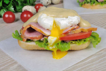 Sandwich with ham and poached egg with mustard sauce