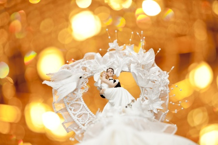 Bride and groom on top of a wedding cake