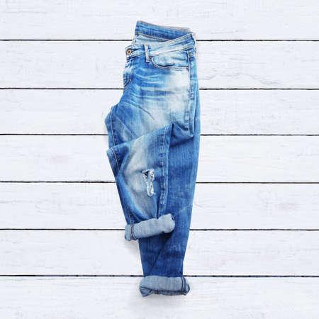 Foto de jeans on a white wooden background - Imagen libre de derechos