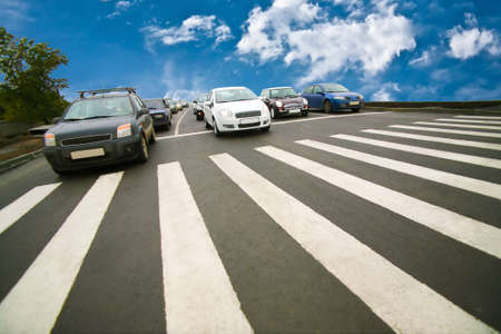 Photo for Cars stopped on pedestrian crossing of city street - Royalty Free Image