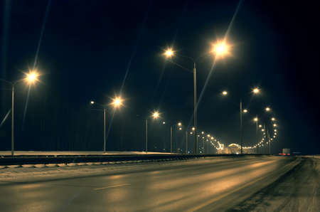 Photo for winter highway at night shined with lamps - Royalty Free Image