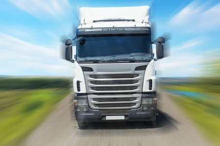truck moves frontally on the highway in the country