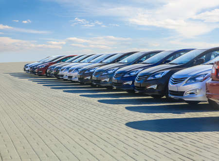 Photo pour Cars For Sale Stock Lot Row. Car Dealer Inventory - image libre de droit