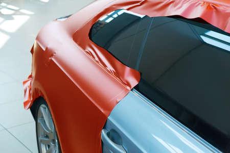 pasting of car carbonic plastic closeup