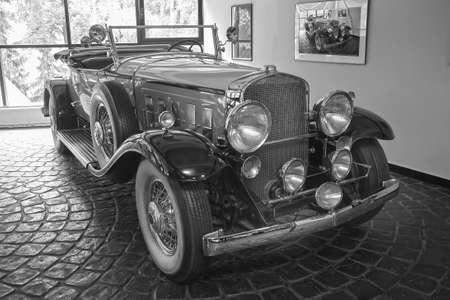 Foto per beautiful ancient car in garage near window - Immagine Royalty Free