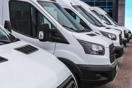 Photo for number of new white minibuses and vans outside - Royalty Free Image