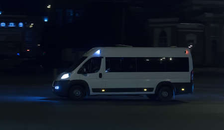 Photo for Minibus Driving Night City Street - Royalty Free Image