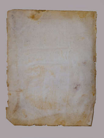 Foto de Sheet of vintage paper isolated on a beige background - Imagen libre de derechos