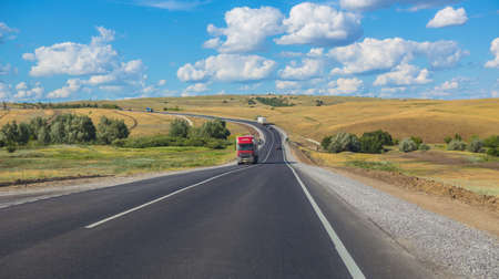 Photo pour Traffic on the Country Road on a bright sunny day. Panorama - image libre de droit