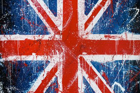 Painted concrete wall with graffiti of British flag. Grunge flag of United Kingdom. Union Jack